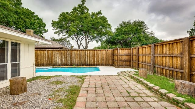 Photo 1 of 26 - 13414 Whispering Hills Dr, Dallas, TX 75243