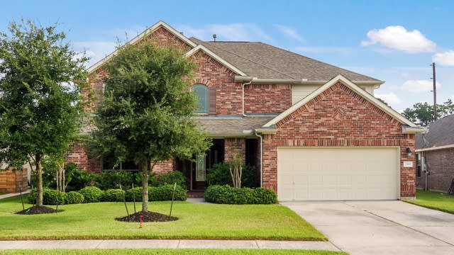 Photo 1 of 25 - 25985 Kingshill Dr, Kingwood, TX 77339