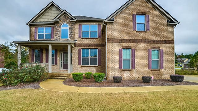 Photo 1 of 28 - 2597 Britt Trail Dr, Lawrenceville, GA 30045