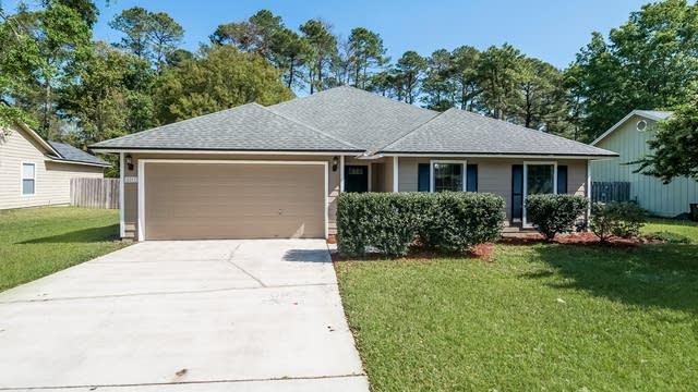 Photo 1 of 24 - 8203 Teaticket Dr, Jacksonville, FL 32244