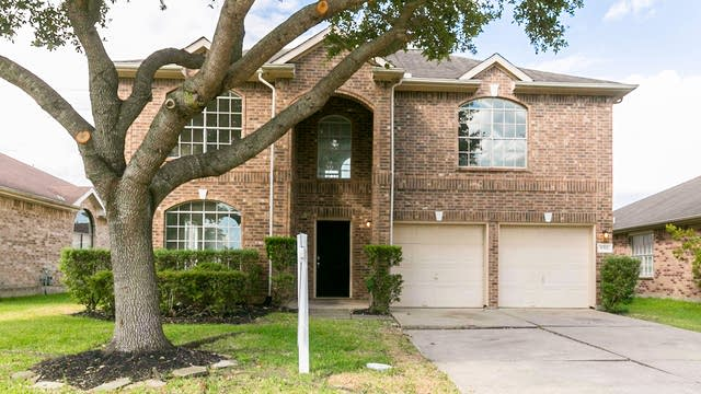 Photo 1 of 29 - 9311 Eaglewood Glen Trl, Houston, TX 77083