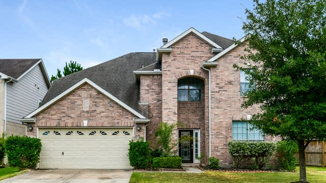 Photo 1 of 25 - 29602 Legends Place Dr, Spring, TX 77386