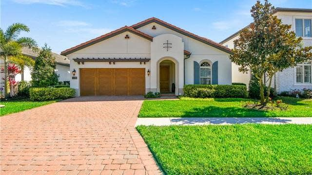 Photo 1 of 27 - 10385 Royal Cypress Way, Orlando, FL 32836