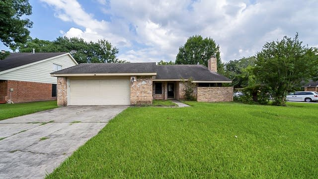 Photo 1 of 35 - 9127 Cypress Square Dr, Spring, TX 77379