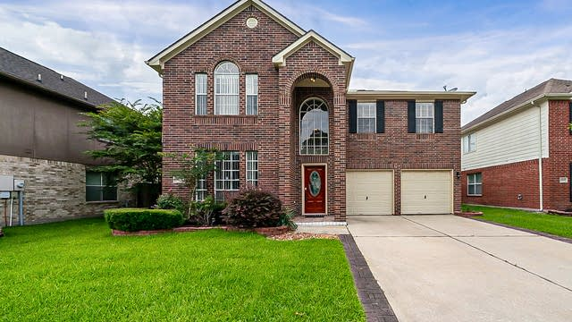 Photo 1 of 36 - 21828 Whispering Forest Dr, Kingwood, TX 77339